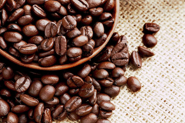 Close Up Photograph - Coffee Beans Spilling From Wooden Bowl by Joseph Clark