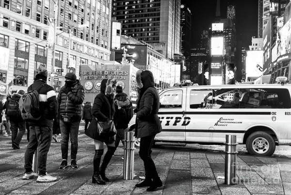 Photograph - Cold At Times Square New York City by John Rizzuto