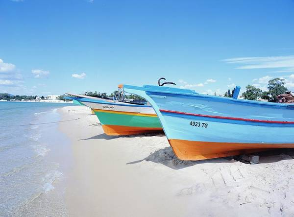 Hammamet Photograph - Colorful Boats On The Beach by Chris Caldicott