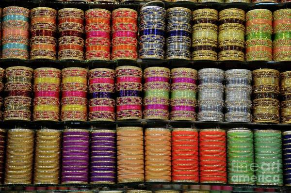 Photograph - Colorful Glass And Metal Bangles On Display At Shop Shelf Clifton Karachi Pakistan by Imran Ahmed