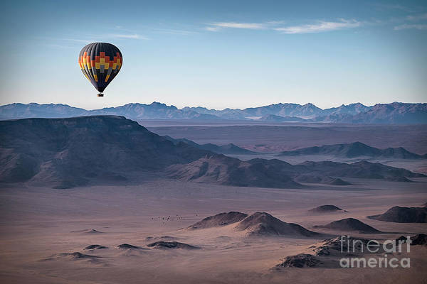 Wall Art - Photograph - Colorful Hot-air Balloon Flying Over by Liz Glasco