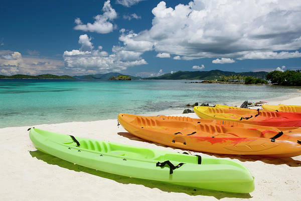 Water Sport Photograph - Colorful Kayaks On A Beach In The by Cdwheatley