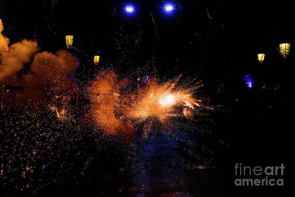Photograph - Colorful Mascleta Full Of Firecrackers And Fireworks With Lots Of Smoke And Sparks. by Joaquin Corbalan