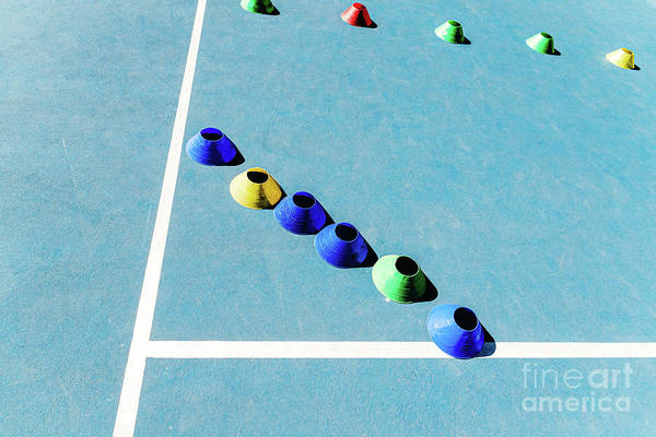 Photograph - Colorful Plastic Cones On A Blue Cement Tennis Court With White  by Joaquin Corbalan