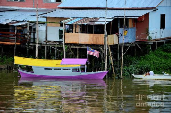 Photograph - Colorful Purple  And Yellow Boat On Sarawak River By Kampong Village Kuching Malaysia by Imran Ahmed
