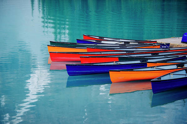 Wall Art - Photograph - Colorful Rowboats Moored In Calm Lake by Panoramic Images
