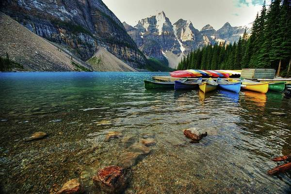 Canoe Photograph - Colourful Canoes At Lake Moraine by Rex Montalban Photography