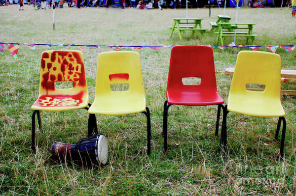 Wall Art - Photograph - Colourful Plastic Chairs by Tom Gowanlock