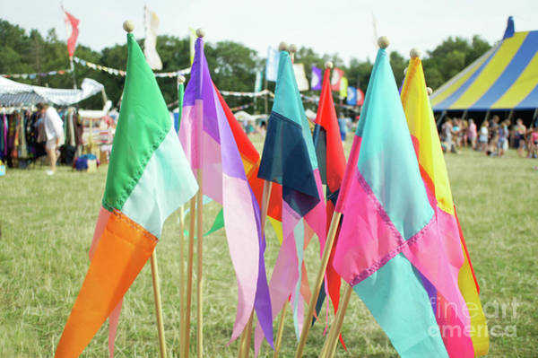 Wall Art - Photograph - Colourful Souvenir Flags by Tom Gowanlock