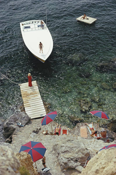 Red Dress Photograph - Coming Ashore by Slim Aarons