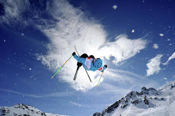 Ski Jumping Photograph - Competitive Mogul Skier Jumps Off A by Agence Zoom