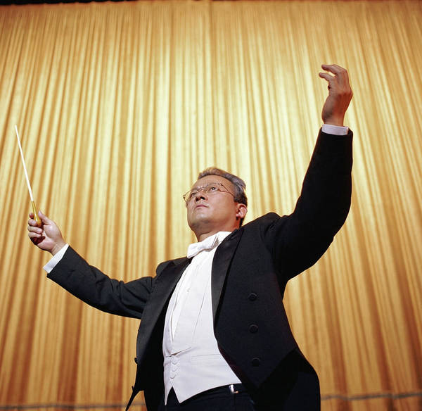 Wall Art - Photograph - Conductor Standing With Arms Raised by Mike Powell