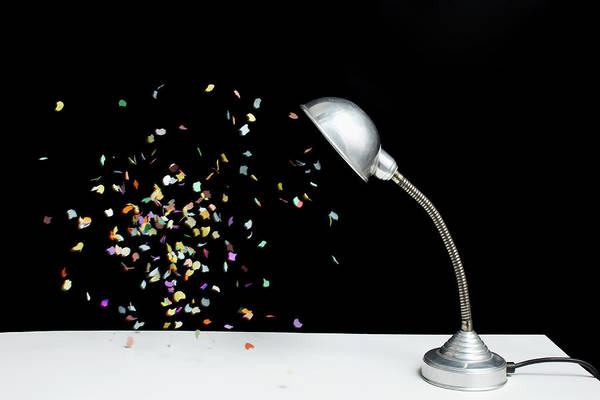 Social Event Photograph - Confetti Floating Next To A Table Lamp by Benne Ochs