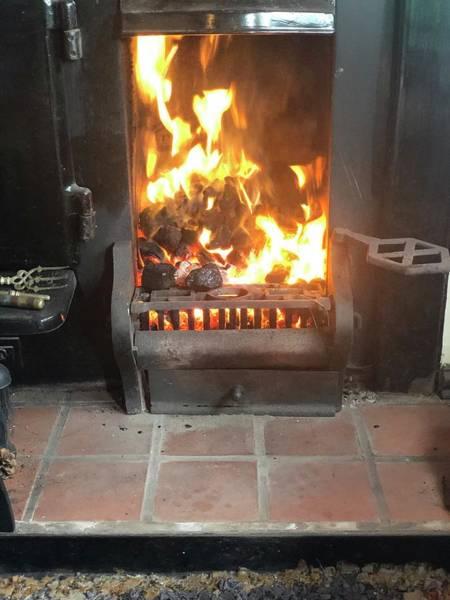 Photograph - Cosy Winter Fire by John Dakin