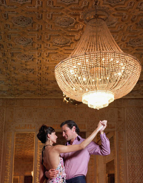 Heterosexual Couple Photograph - Couple Dancing Beneath Chandelier, Low by Justin Pumfrey