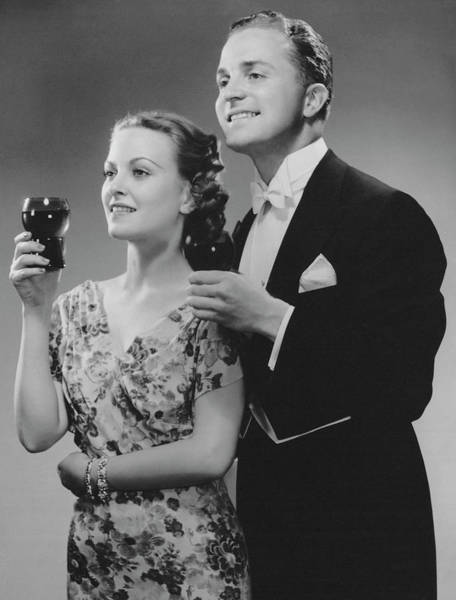 Heterosexual Couple Photograph - Couple Dressed Up Holding Drinks by George Marks