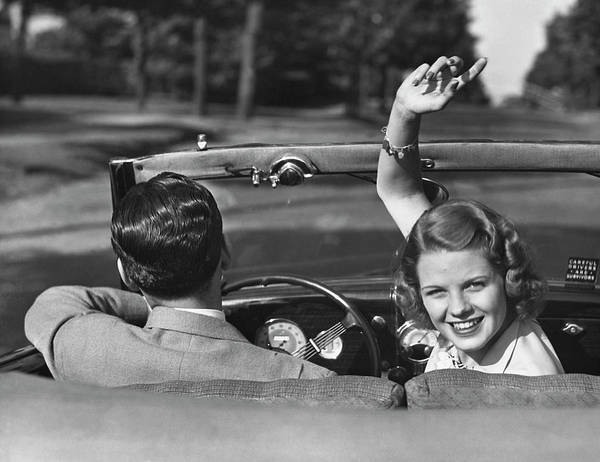 Heterosexual Couple Photograph - Couple Driving In Convertible by George Marks