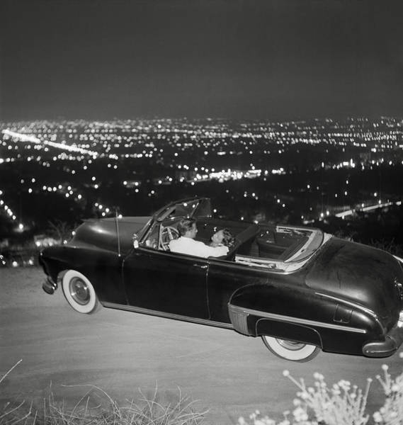 Relationship Photograph - Couple In Convertible On Mulholland by Michael Ochs Archives