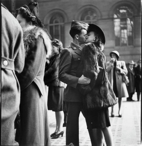 Wall Art - Photograph - Couple In Penn Station Sharing Farewell by Alfred Eisenstaedt