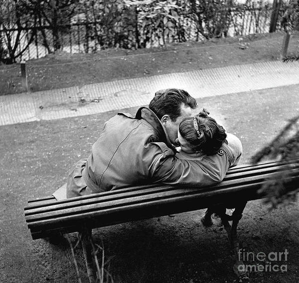 Wall Art - Photograph - Couple Of Lovers Kissing On A Bench At The Pere Lachaise, Paris, 1955 by Gerald Bloncourt