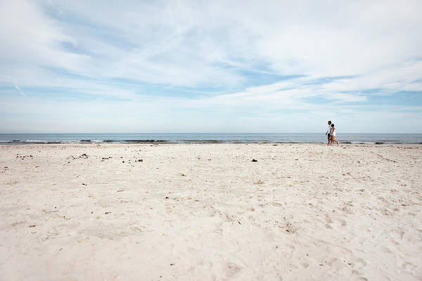Heterosexual Couple Photograph - Couple On Beach by Danvostok