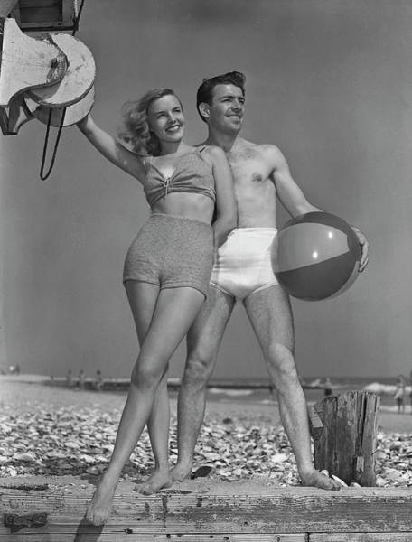 Heterosexual Couple Photograph - Couple On Beach Wbeach Ball by George Marks