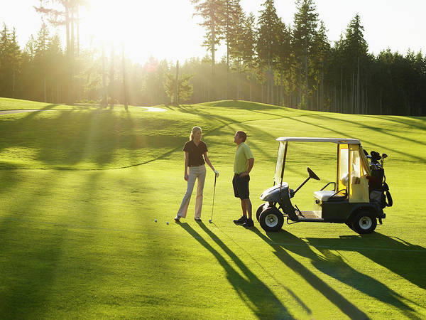 Golf Photograph - Couple On Golf Course With Golf Cart by Thomas Barwick