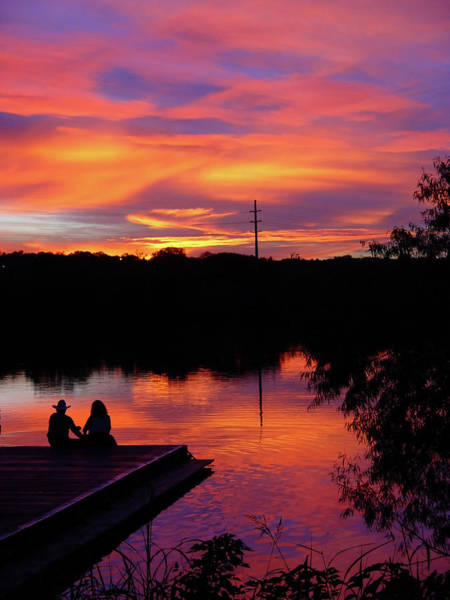 Heterosexual Couple Photograph - Couple On The Dock And A Sunset by Tomwald