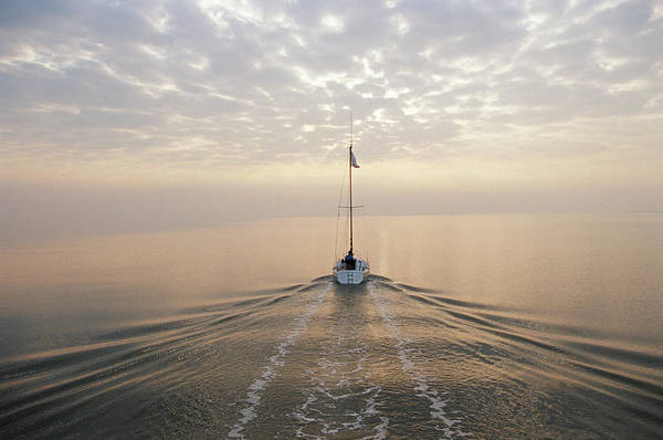 Wall Art - Photograph - Couple On Yacht In Open Water, Rear View by Colin Gray