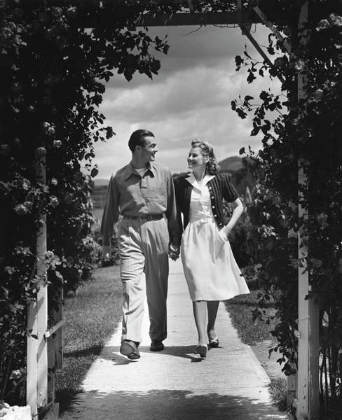 Wall Art - Photograph - Couple Outdoors Holding Hands While by George Marks
