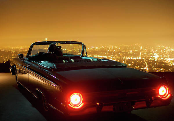 Romance Photograph - Couple Parking In Convertible At Night by Ojo Images