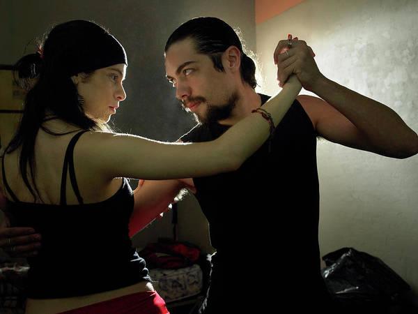 Practice Photograph - Couple Practising Tango In Dark Room by Hans Neleman