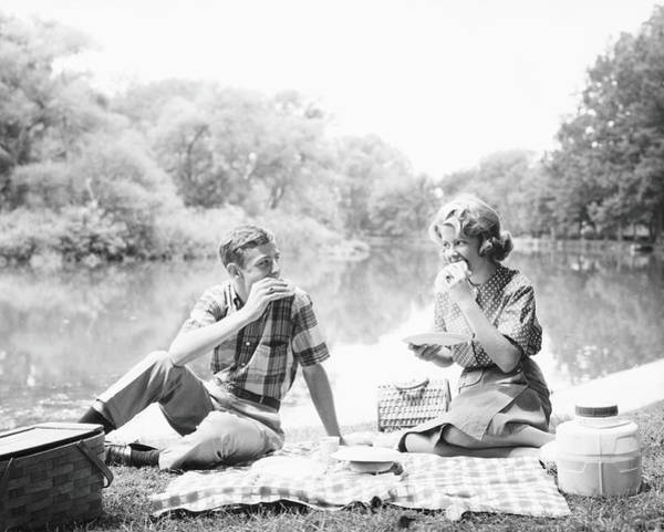 Heterosexual Couple Photograph - Couple Seated On Checkered Tablecloth by H. Armstrong Roberts