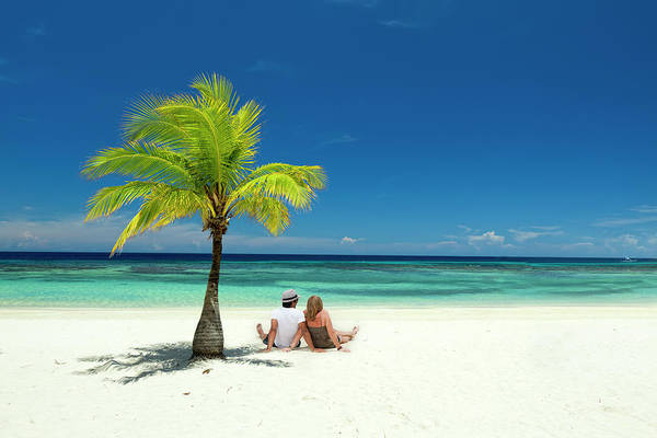 Heterosexual Couple Photograph - Couple Sitting On Tropical Beach by Dstephens