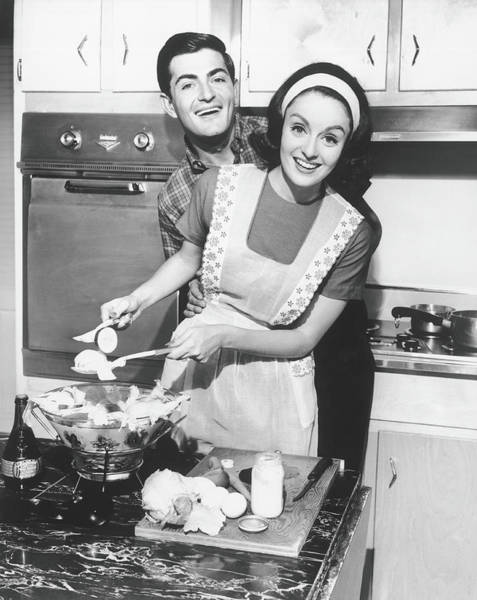 Headband Photograph - Couple Standing In Kitchen, Smiling, B&w by George Marks
