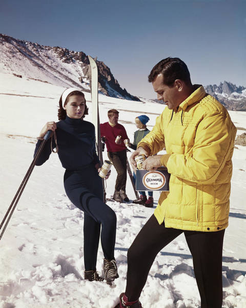 Photograph - Couple Standing In Snow Holding Drinks by Tom Kelley Archive
