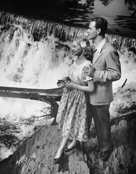 Heterosexual Couple Photograph - Couple Standing Near Waterfall by George Marks