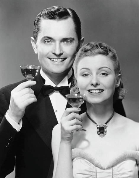 Heterosexual Couple Photograph - Couple W Champagne Glasses by George Marks