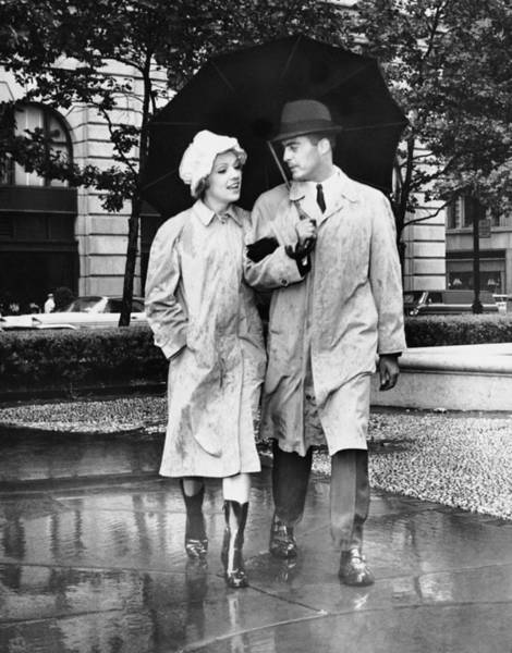 Heterosexual Couple Photograph - Couple Wumbrella Walking In The Rain by George Marks