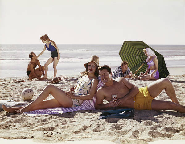 1958 Photograph - Couples Having Fun On Beach, Smiling by Tom Kelley Archive
