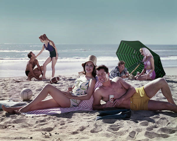 Alcohol Photograph - Couples On The Beach by Tom Kelley Archive