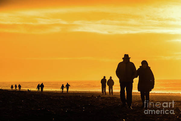 Photograph - Couples Walking Along The Beach At Sunset by Keith Morris