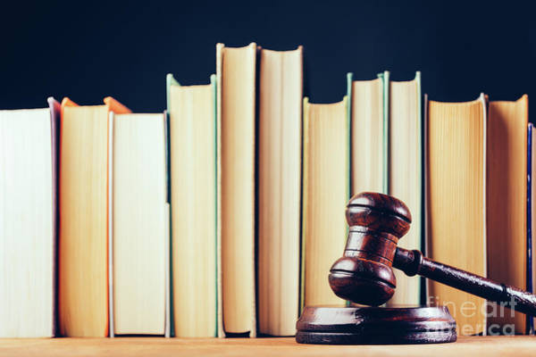 Photograph - Court Hammer And Books On Black Background. by Michal Bednarek