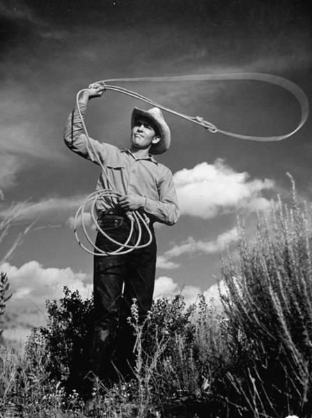 Ranch Photograph - Cowboy At The Matador Ranch In Texas Swi by Hansel Mieth