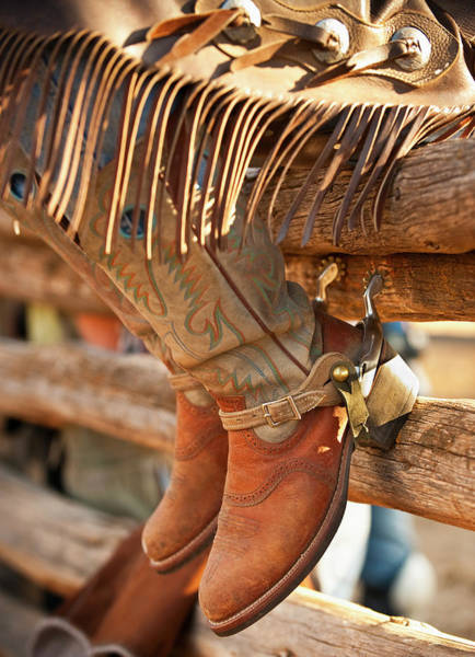 Toughness Photograph - Cowboy Boots On Fence by Tetra Images