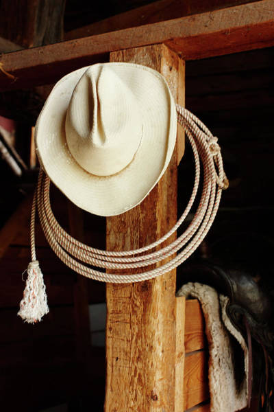 Wall Art - Photograph - Cowboy Hat Hanging In Barn With Rope by Nash Photos