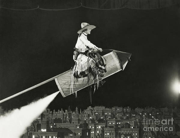 Caucasian Wall Art - Photograph - Cowgirl Takes Off On A Rocket by Everett Collection