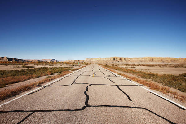 Cracked Photograph - Cracked Desert Road Leading Into The by Gary Yeowell