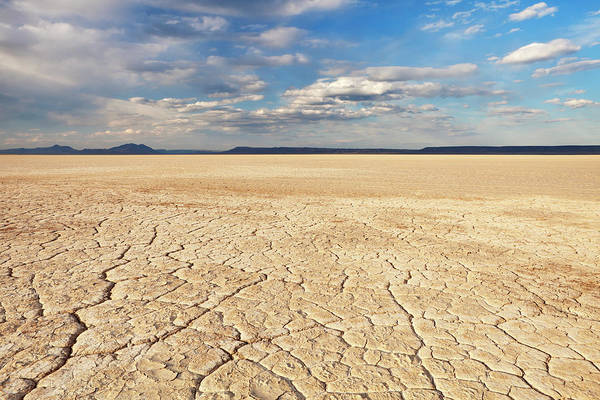 Cracked Photograph - Cracked Earth In Remote Alvord Desert by Sara winter
