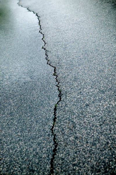 Cracked Photograph - Cracked Surface Of Road, Full Frame by Julio Lopez Saguar